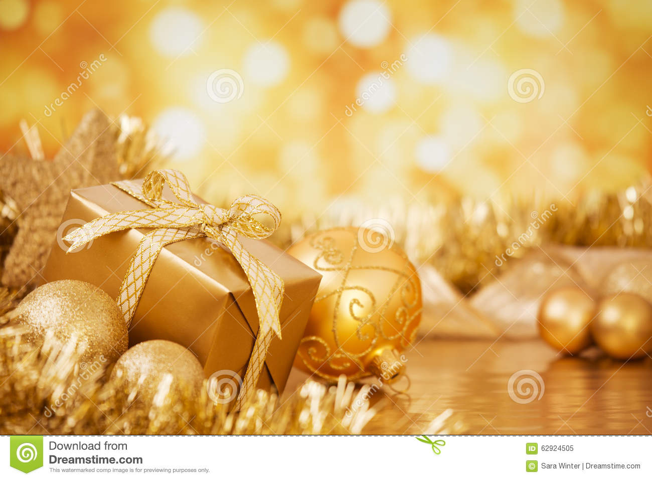 Christmas Scene With Gold Baubles And Gift, Gold Background Stock ...