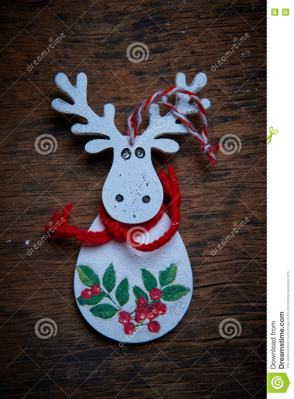 Christmas scenery. A white elk with the red drawing against a dark background.