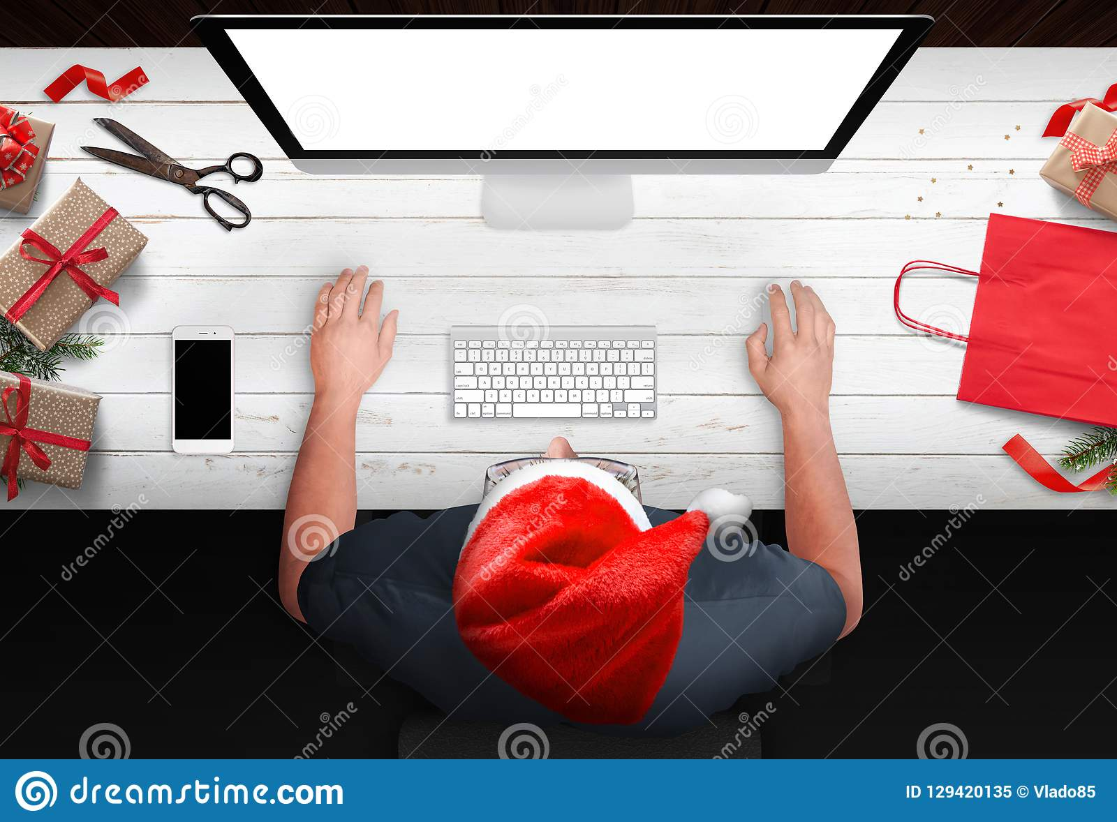 321372fa951 Christmas shopping from the armchair. Man buy gifts online at discounts. Bag