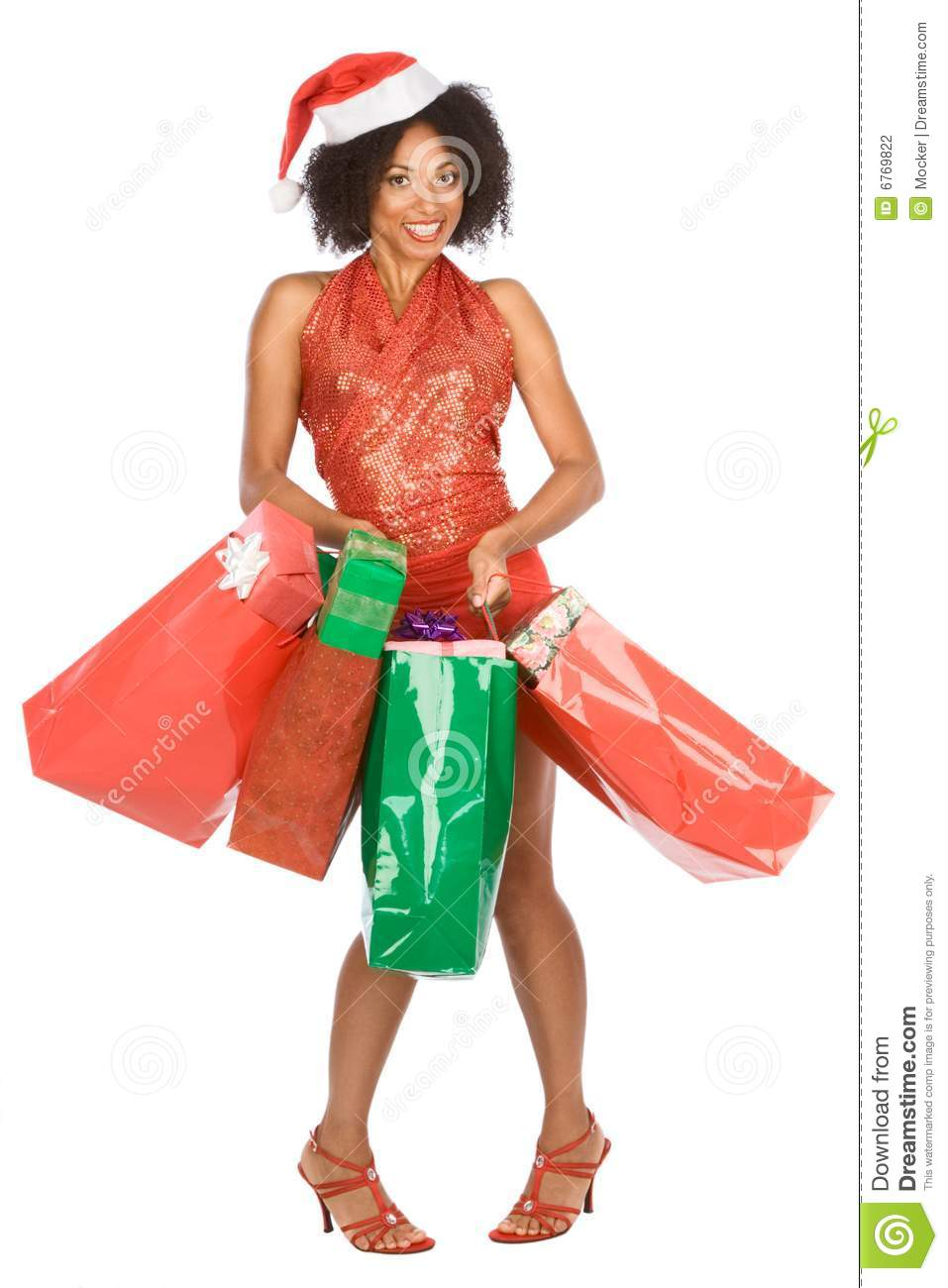 Christmas Shopping Ethnic Woman With Lot Of Gift Stock