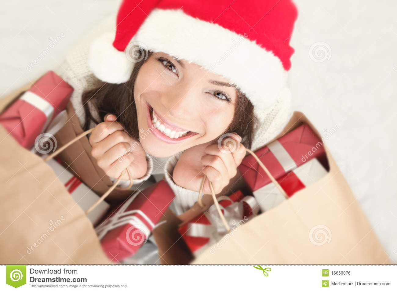Christmas shopping santa woman with gift bag