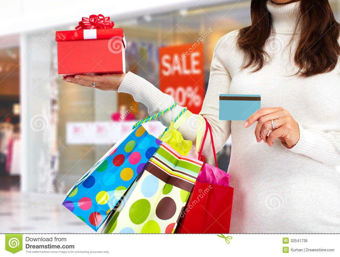 Christmas Shopping Woman With Gift Royalty Free Stock