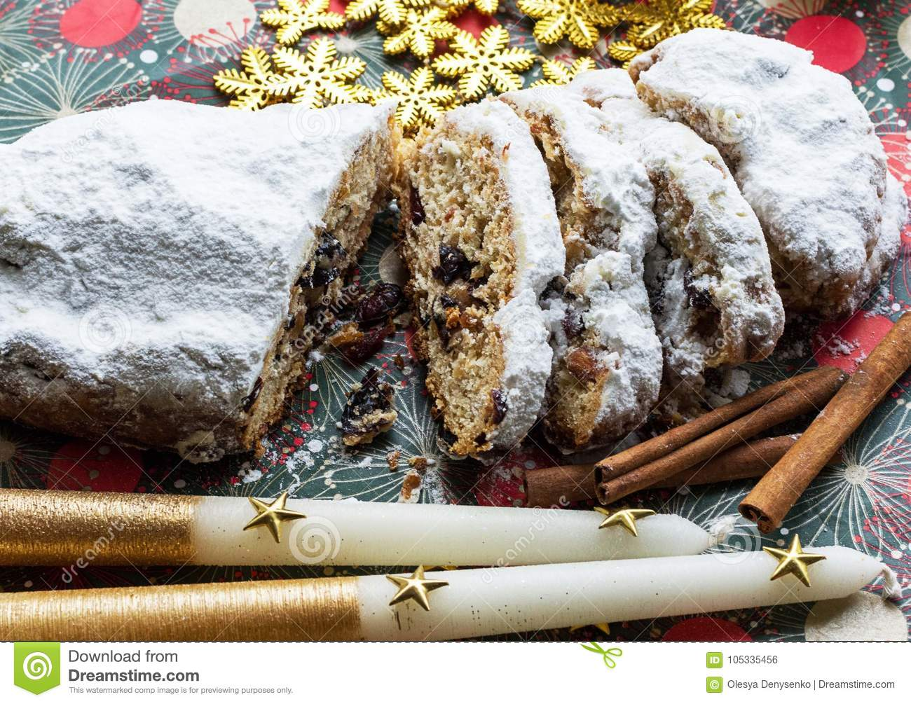 Christmas shtollen on a green background. Traditional German dessert