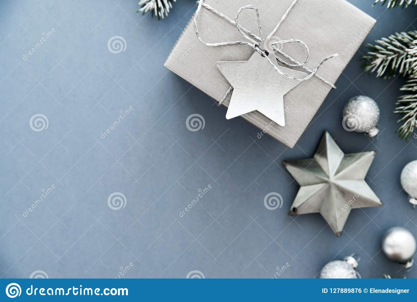 Christmas silver handmade gift boxes on blue background top view. Merry Christmas greeting card, frame. Winter xmas holiday theme.