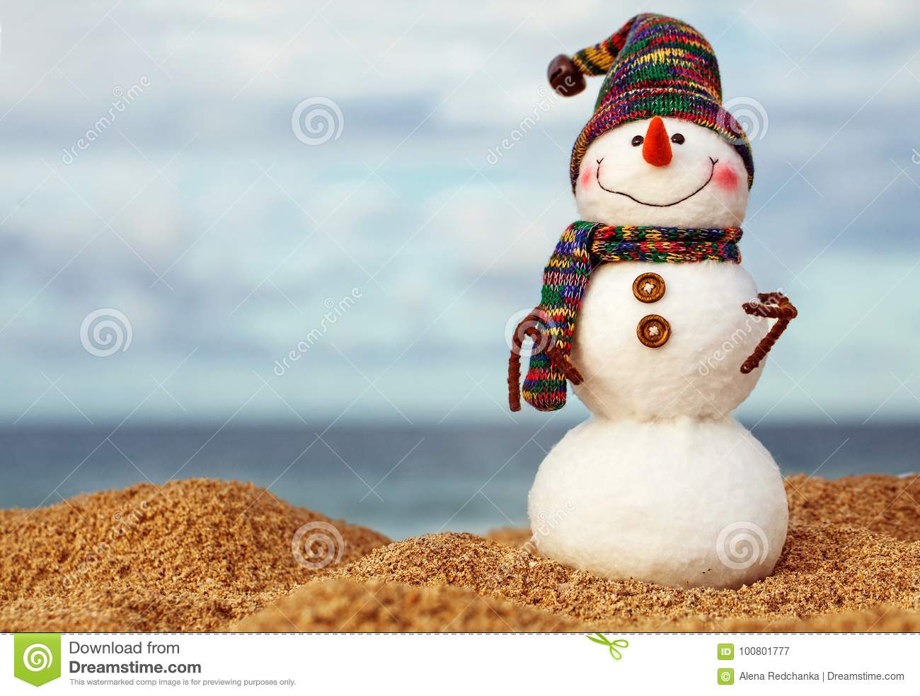 f68a1b8aa1edc Christmas snowman in red santa hat and sunglasses at sunny beach. Holiday  concept for New Years Cards