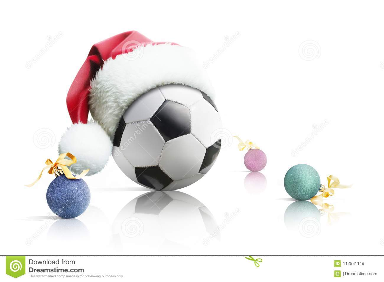 Christmas soccer. Soccer ball in santa hat Christmas toys on a white background. Isolated