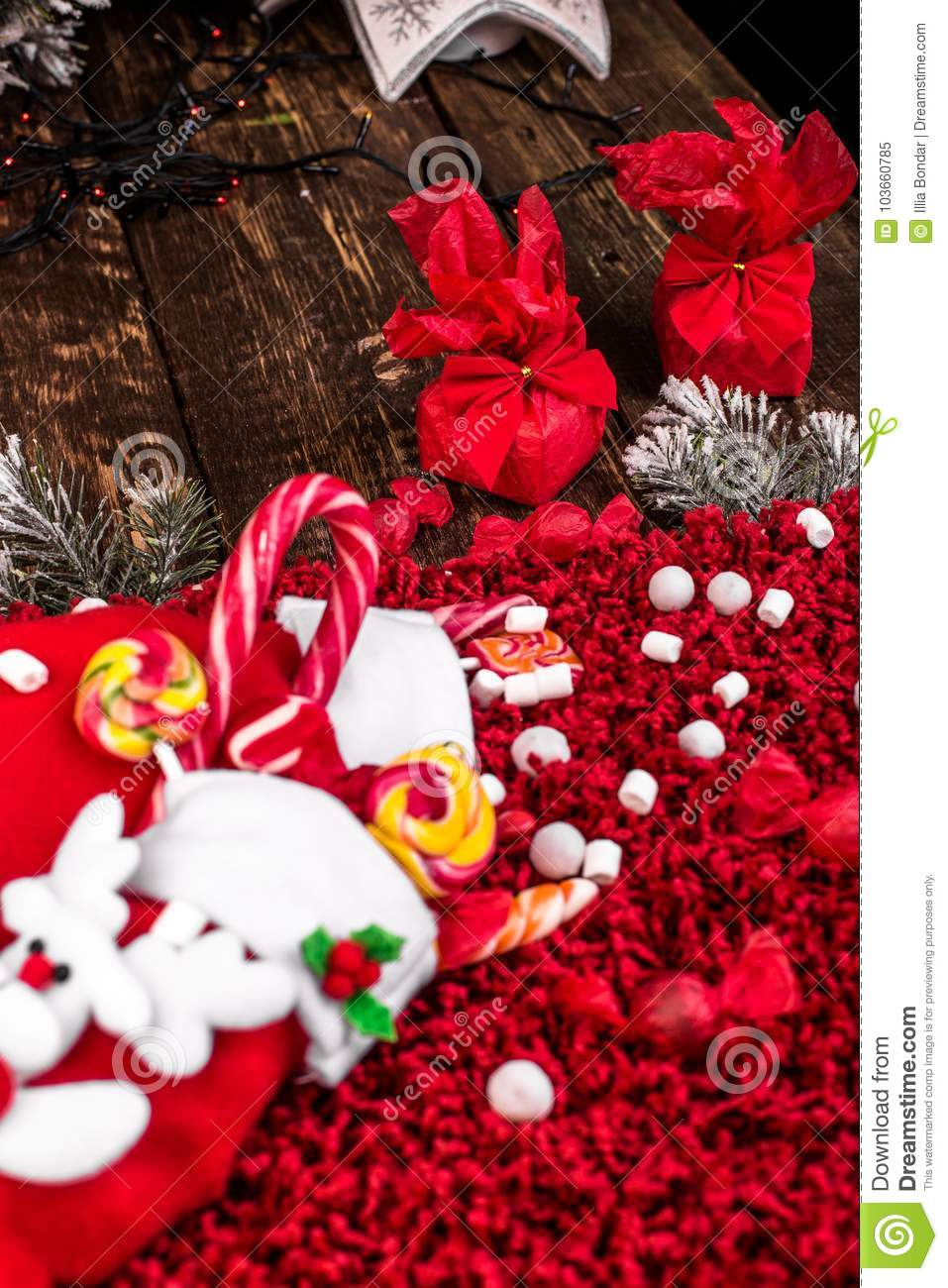 download christmas socks full of candy and sweets on red fleecy background flat lay