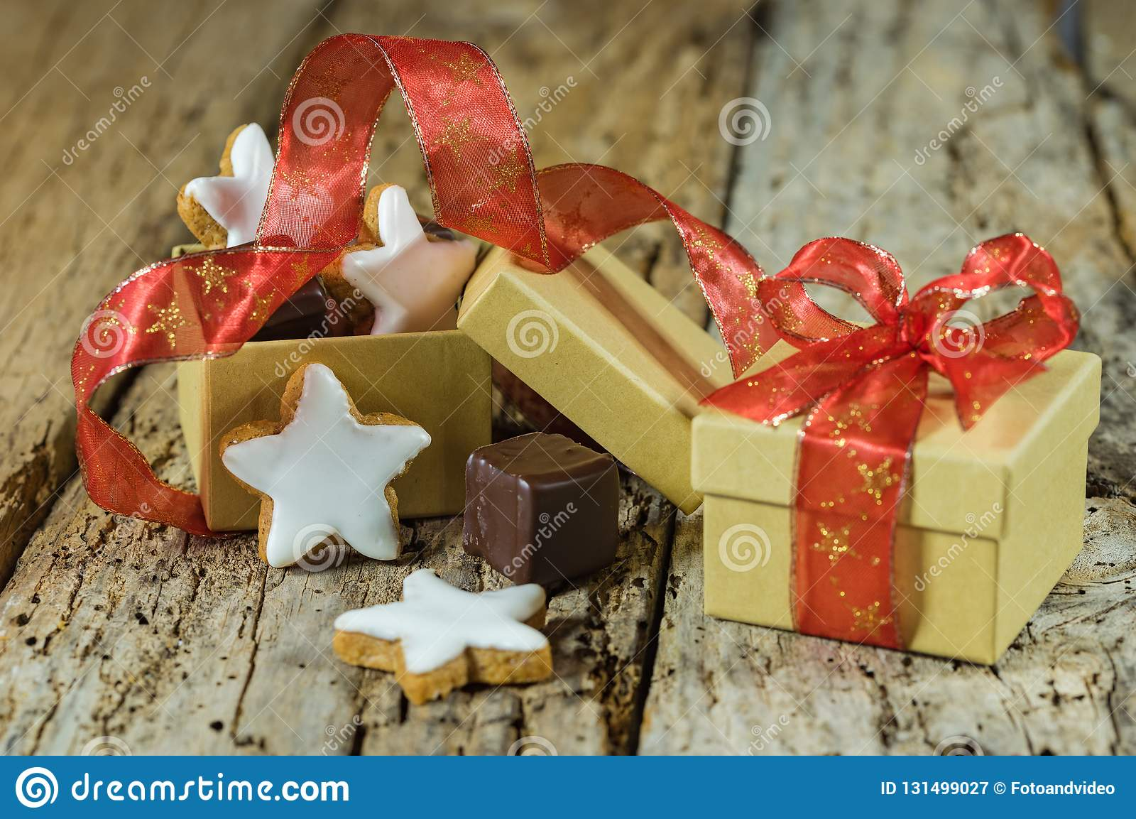 Christmas Star Cookies And Sweet Chocolate Gift With Red Ribbon Bow