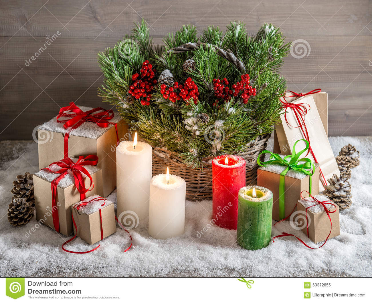 Christmas still life with burning candles and gift box