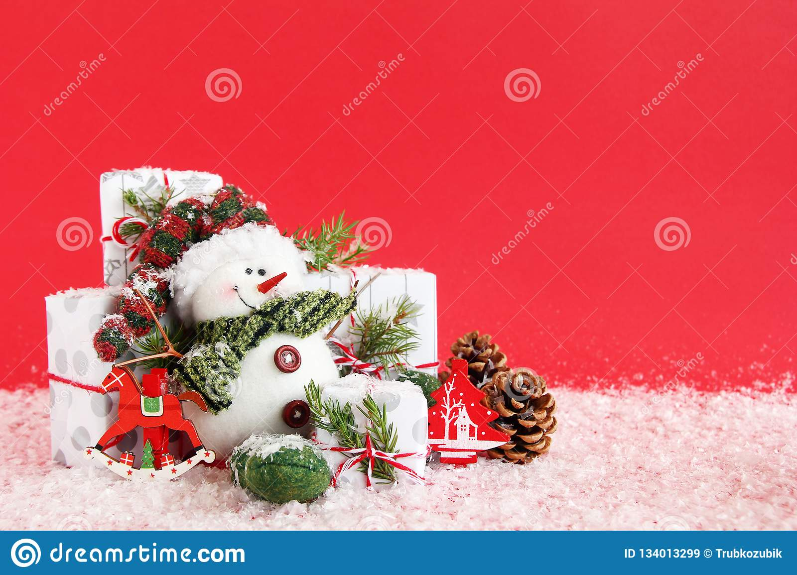 Christmas Still Life With Snowman And Gift Boxes On A Red Background