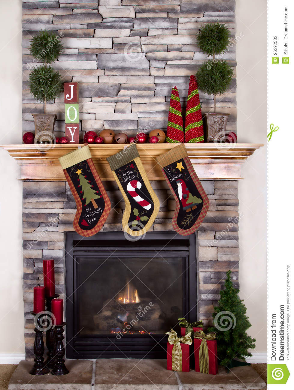 christmas stockings hanging from fireplace stock photography
