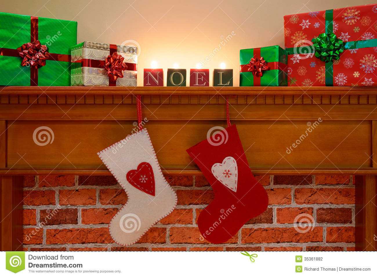 Christmas Stockings Under The Mantlepiece Stock Photo