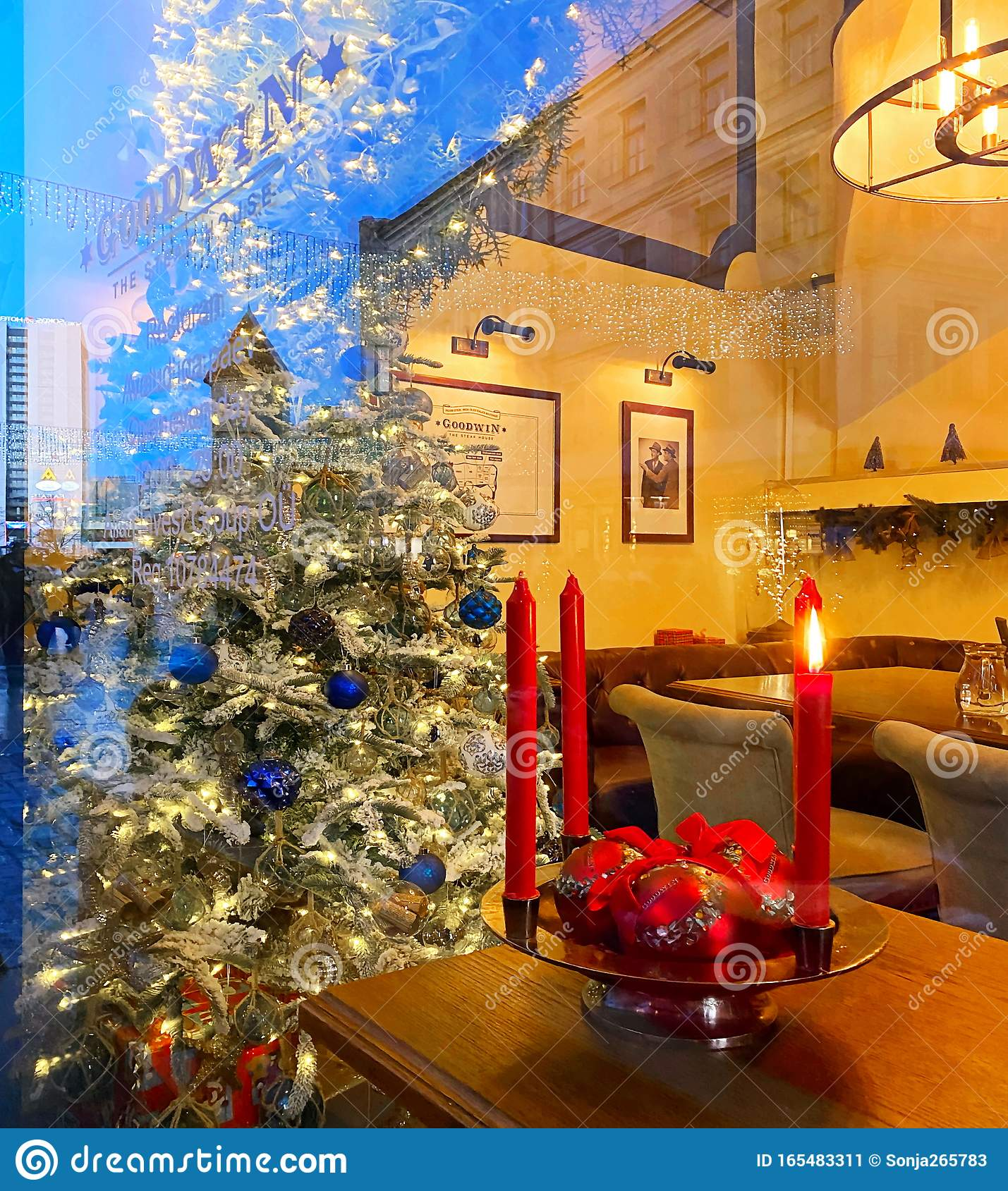 Christmas Street Cafe Evening Light Windows Reflection Christmas Red Candle On Table Top In Restaurant Yellow Blue Red Shop Stock Image Image Of Light Cityscape 165483311