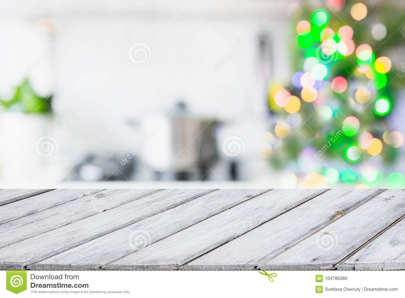 Christmas table background with christmas tree in kitchen out of focus. Background for display your products.