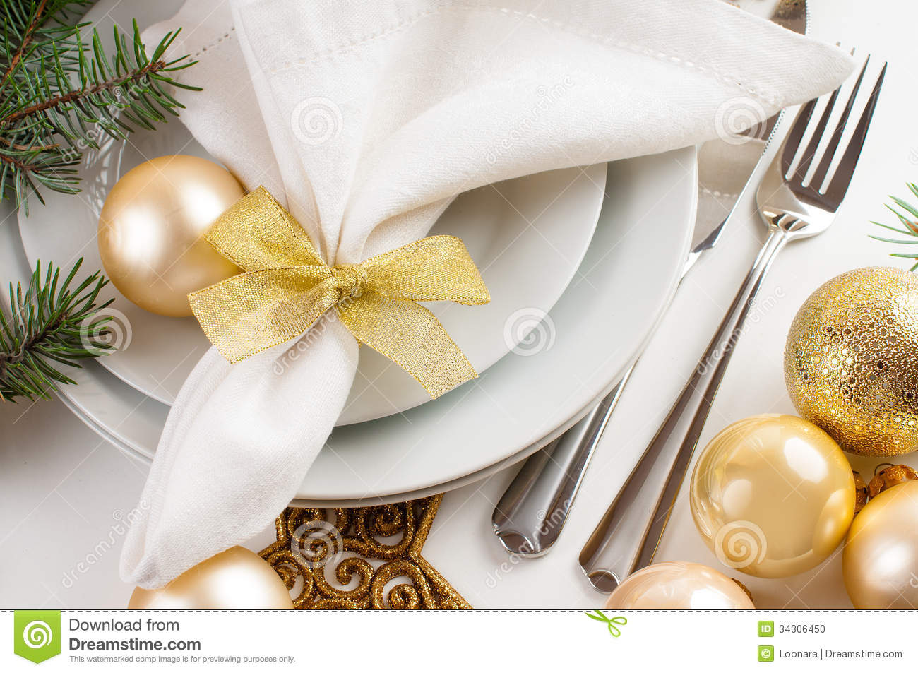 Christmas table decorations gold - Christmas Table Setting In Gold Tones Stock Photo