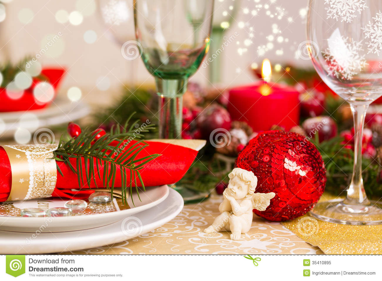 Christmas table decorations gold - Christmas Table Setting With Holiday Decorations Royalty Free Stock Photo