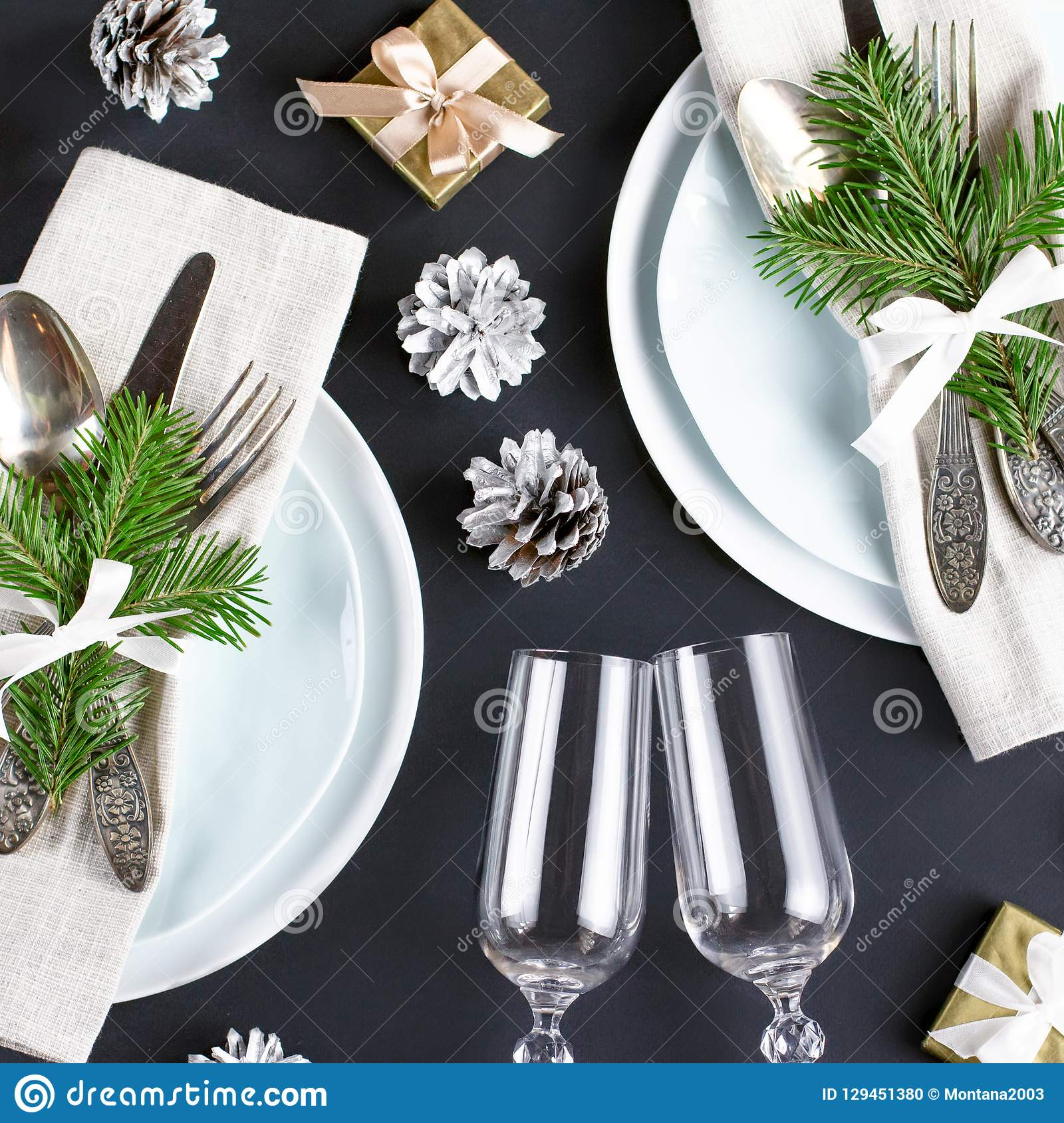 Christmas Table Setting With Plates Silverware Gift Box And