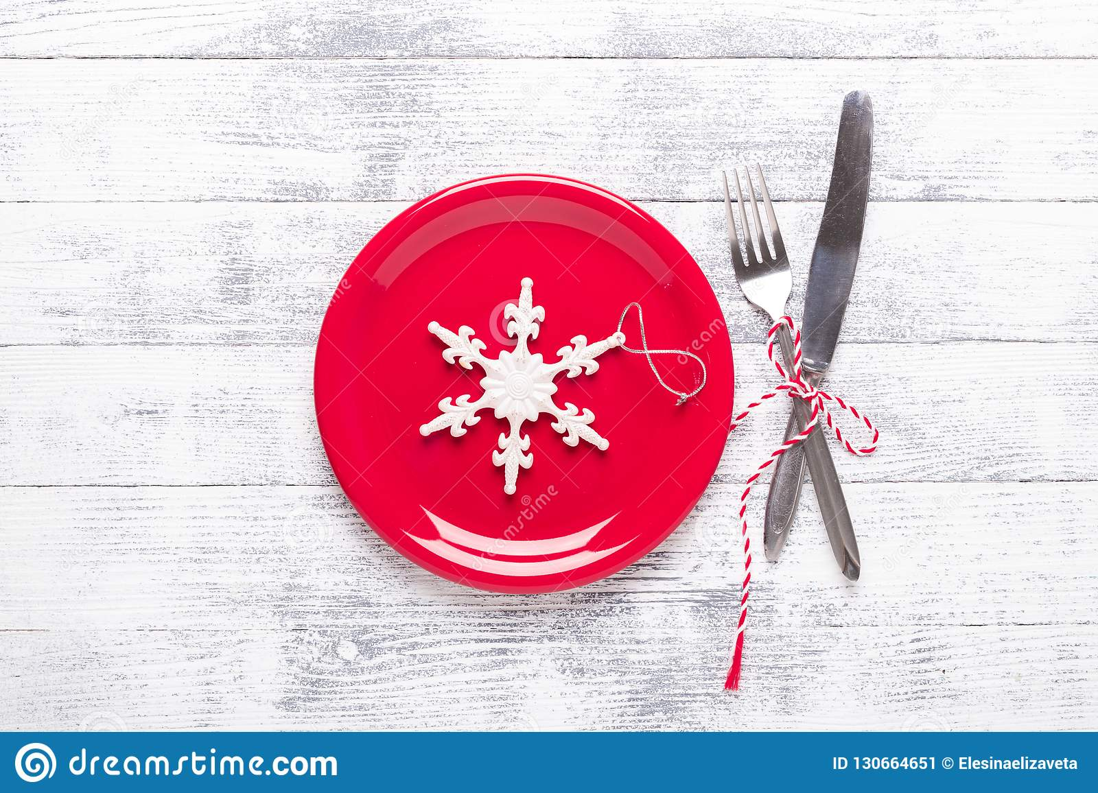 Phenomenal Christmas Table Setting With Red Plate Silverware On Light Download Free Architecture Designs Grimeyleaguecom