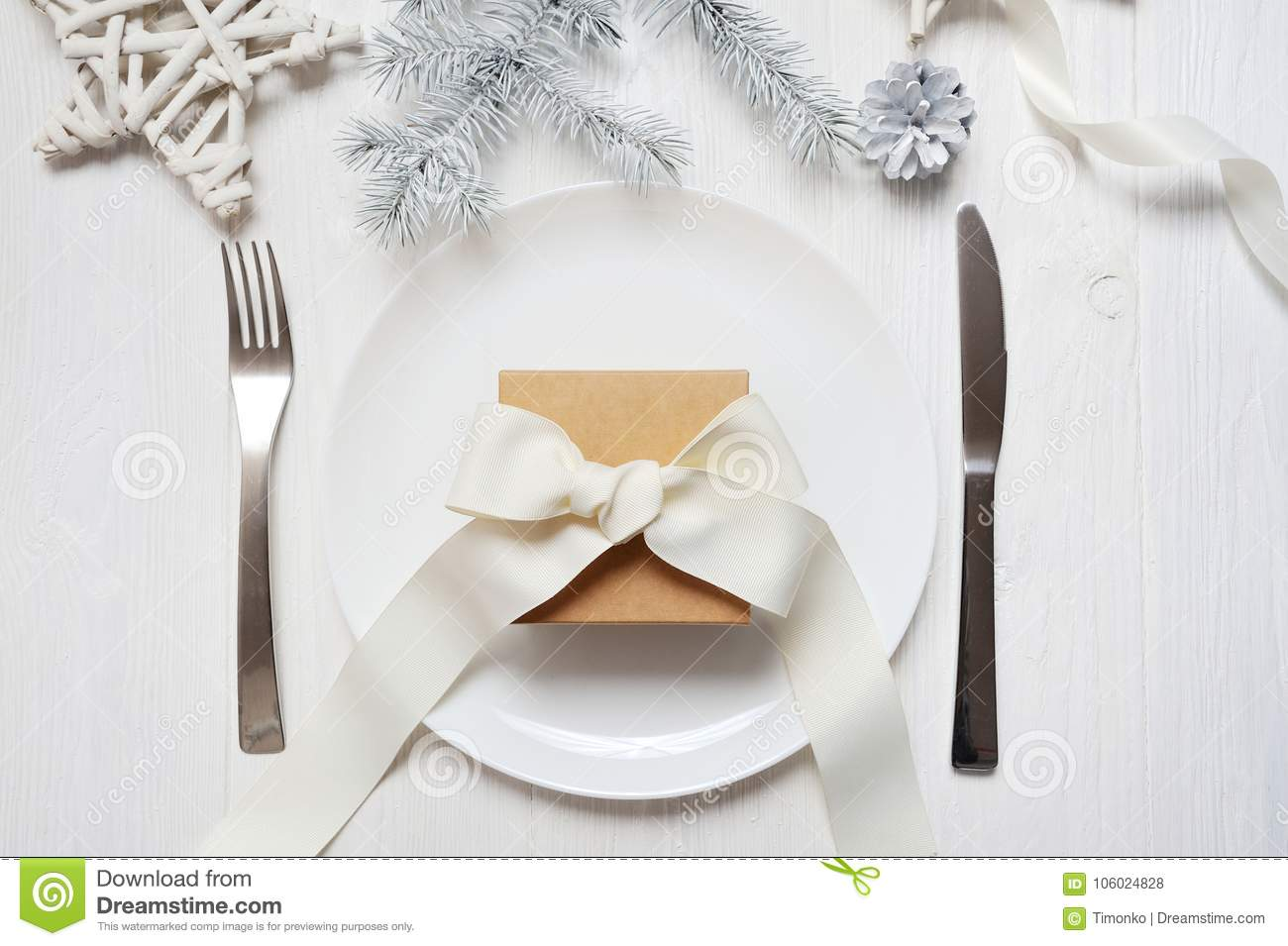 Christmas Table Setting With A Vintage Gift On White Wooden Table