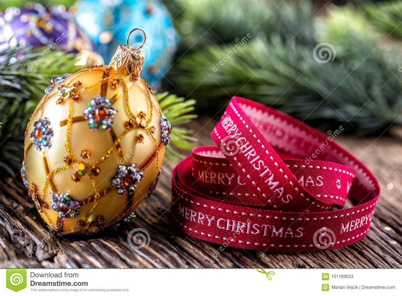 Christmas Time. Luxury golden purple blue christmas ball and decoration.Red ribbon with text happy christmas