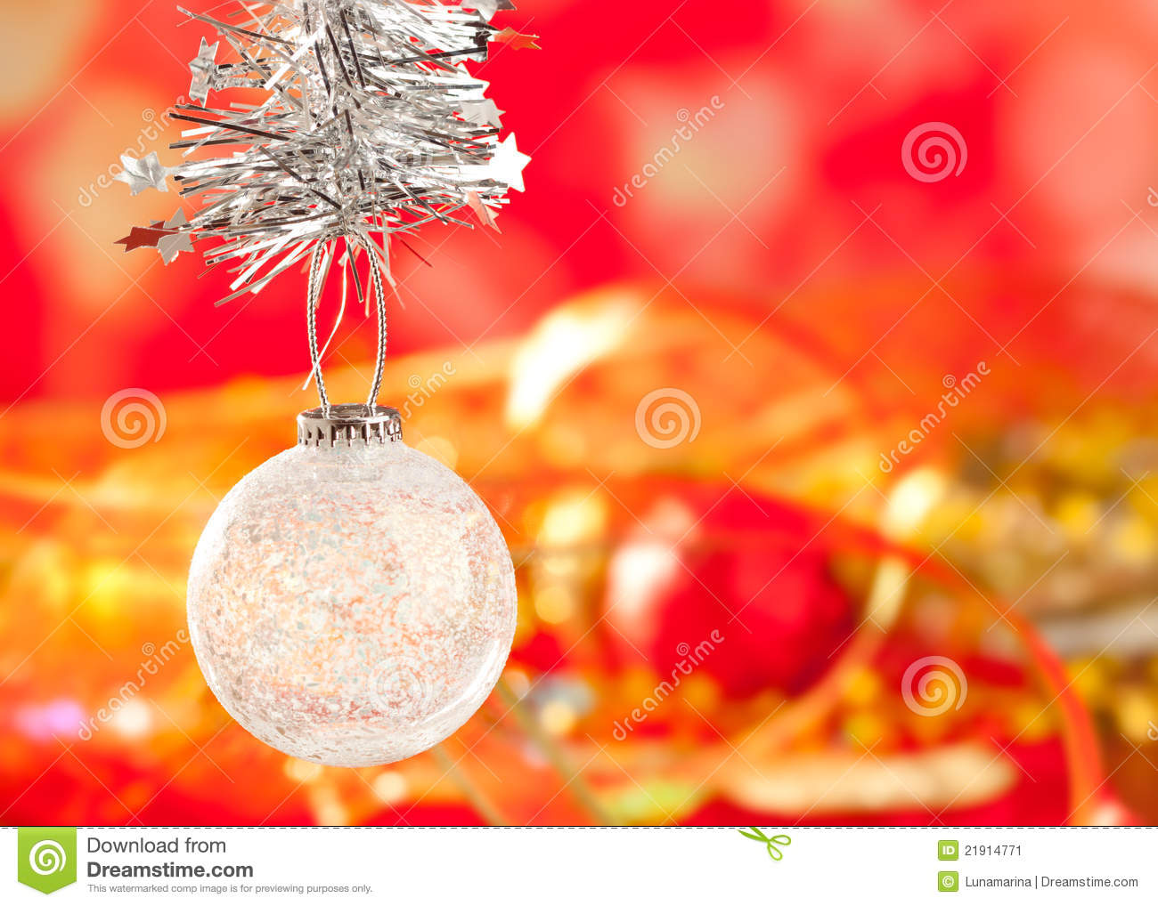 Christmas tinsel snow crystal bauble on red stock image for Crystal baubles christmas