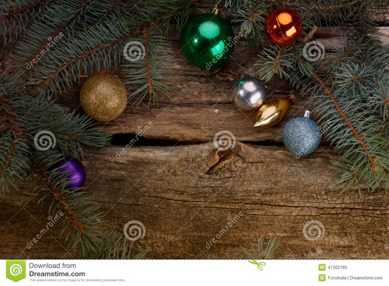 Christmas toys and branches of tree lit candle