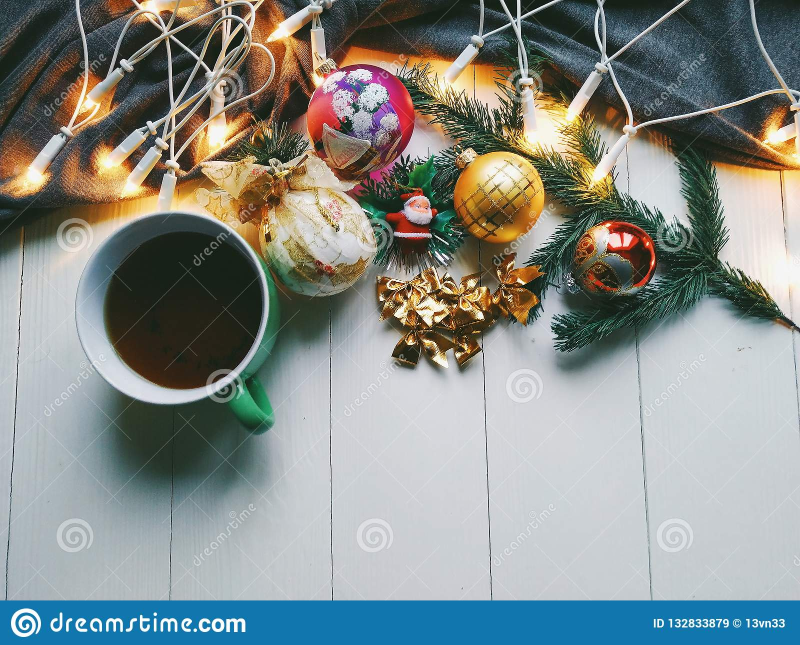 Christmas Toys A Cup Of Hot Tea And Christmas Tree Garland On A