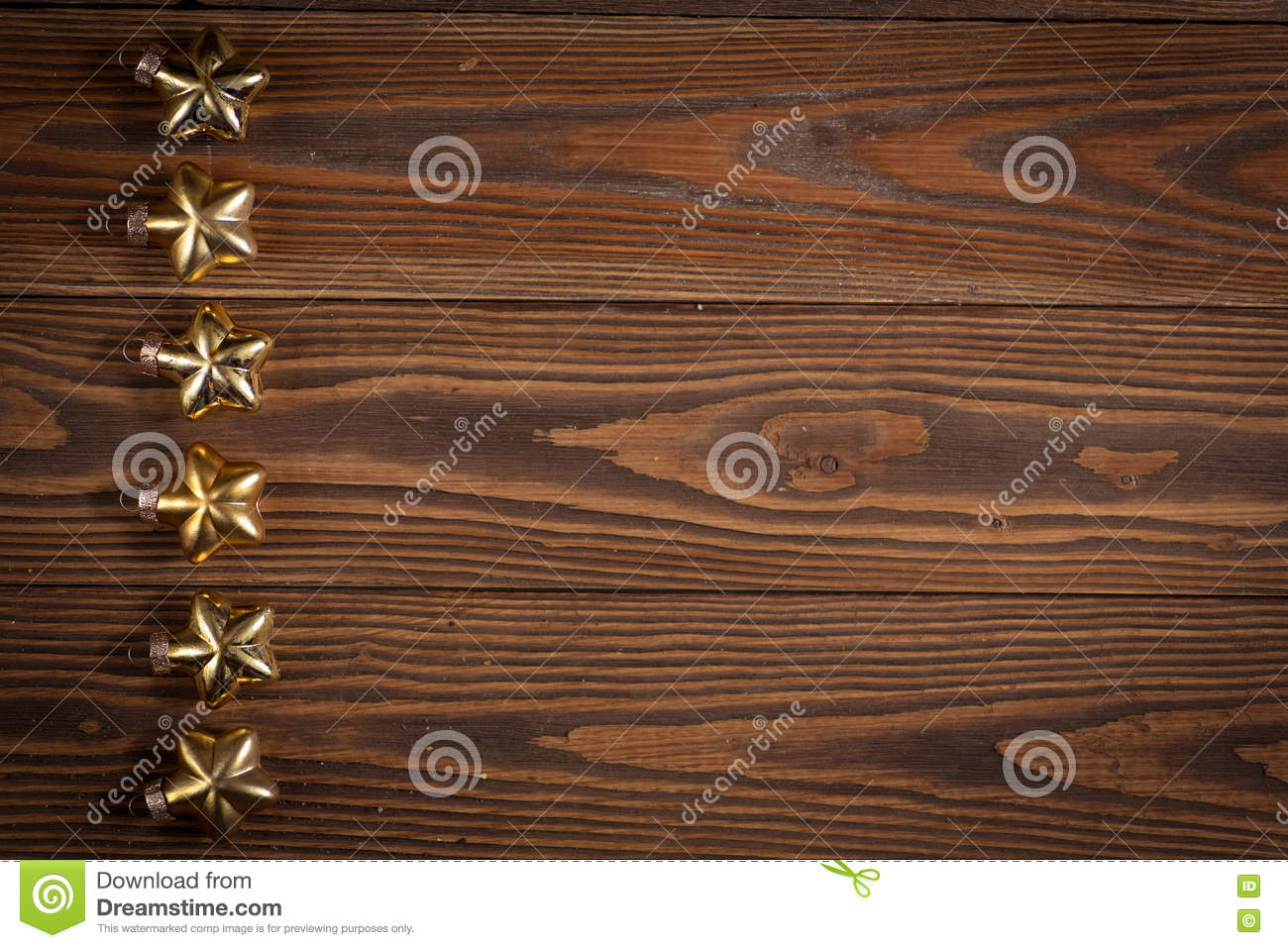 copyspace christmas toys golden stars on wooden background concept christmas and new year copyspace