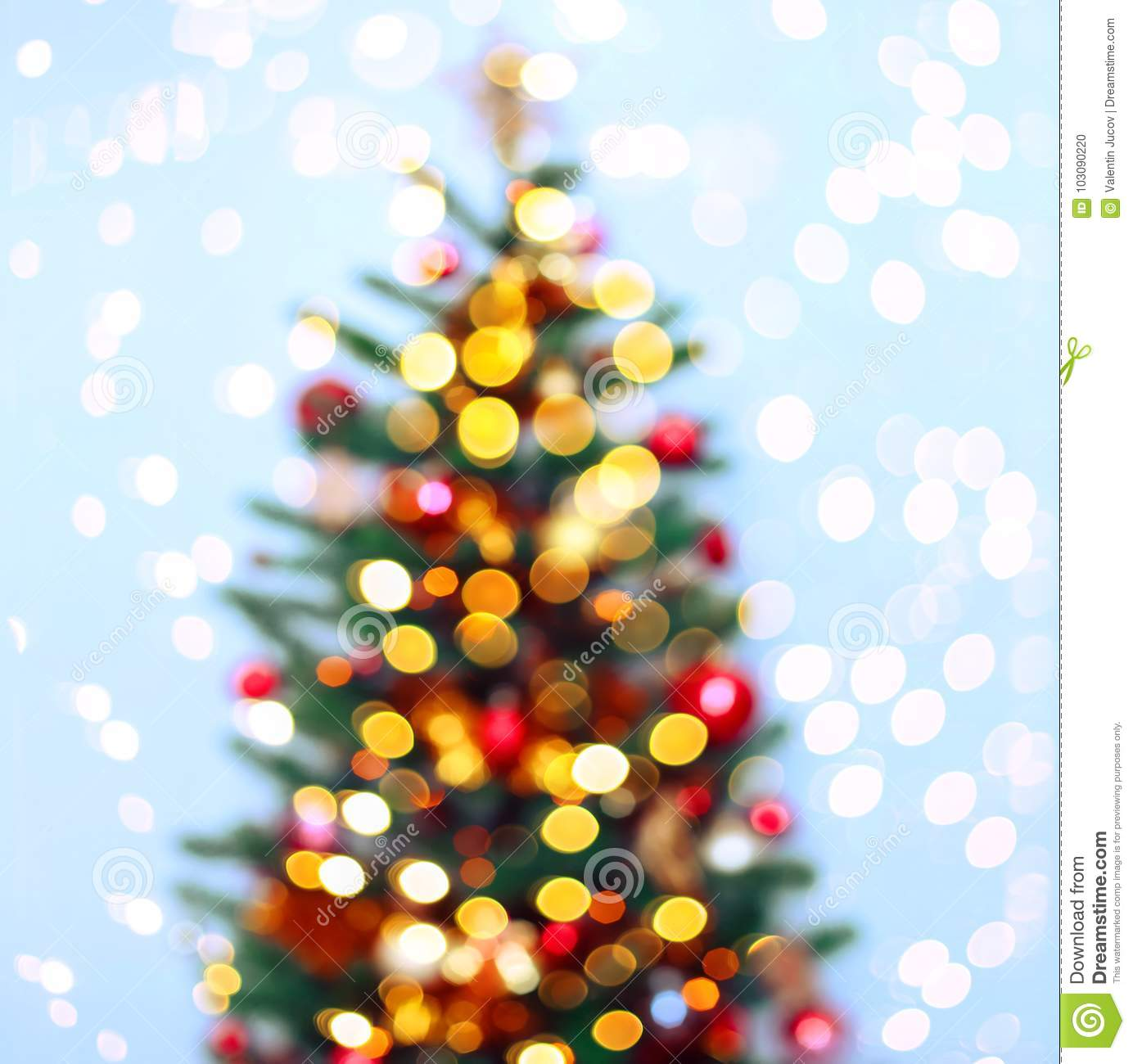 Christmas tree background with blurred, sparking, glowing. Happy New Year and Xmas theme.