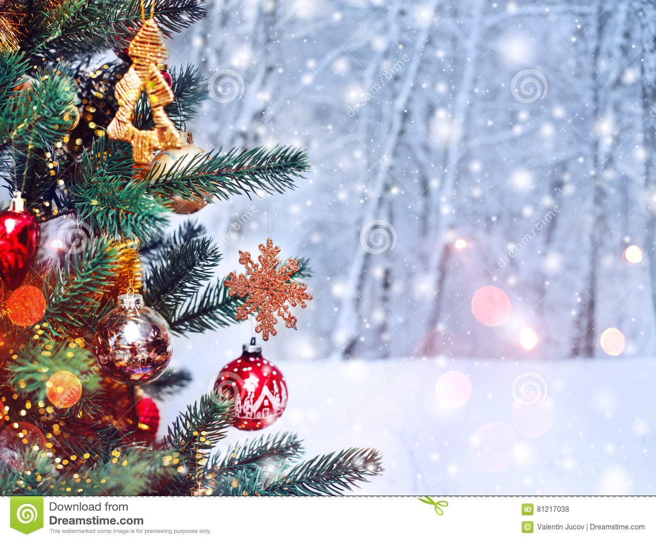 Christmas tree background and Christmas decorations with snow, blurred, sparking, glowing. Happy New Year and Xmas