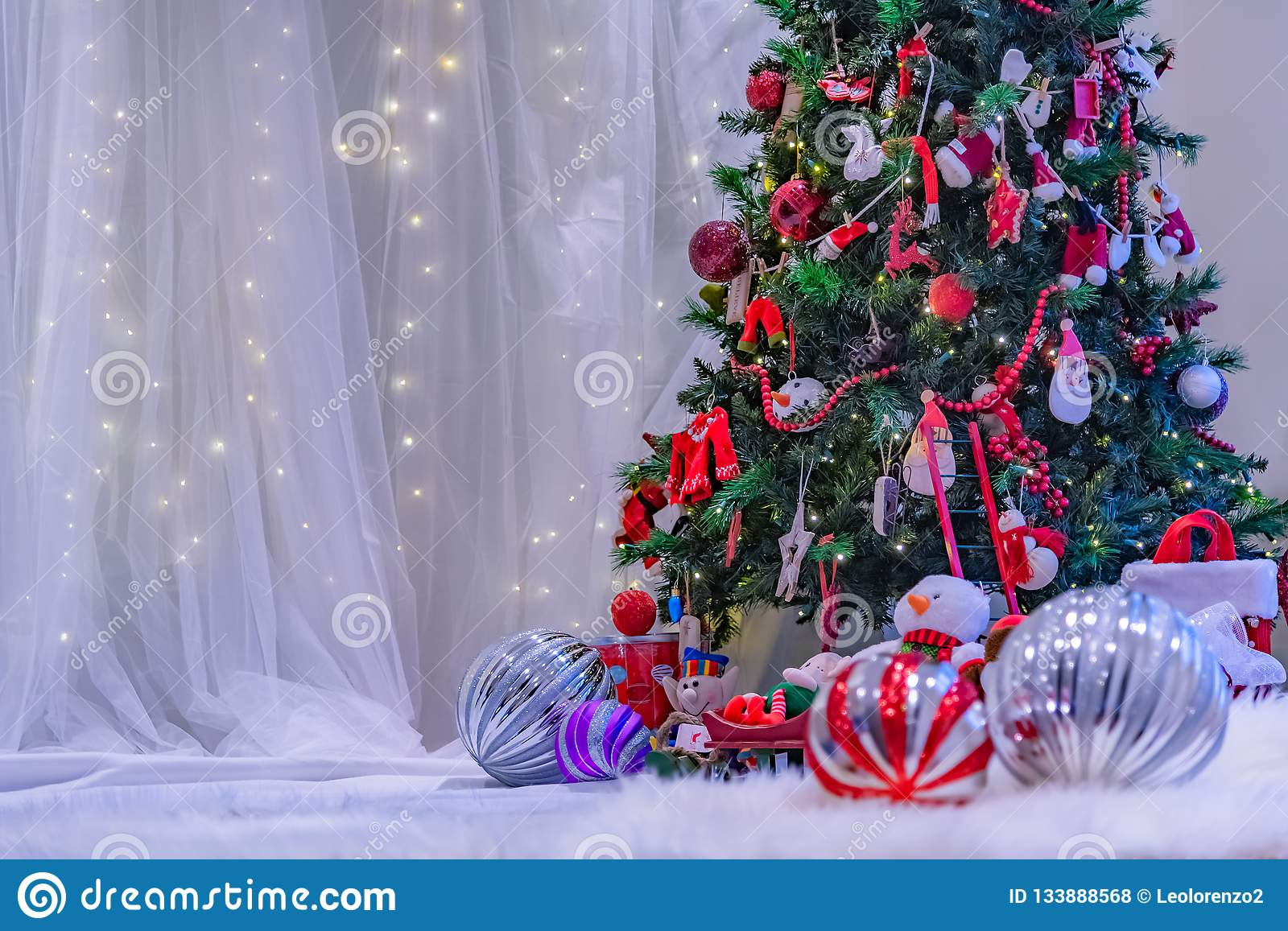 Christmas Themed stage with white backdrop.