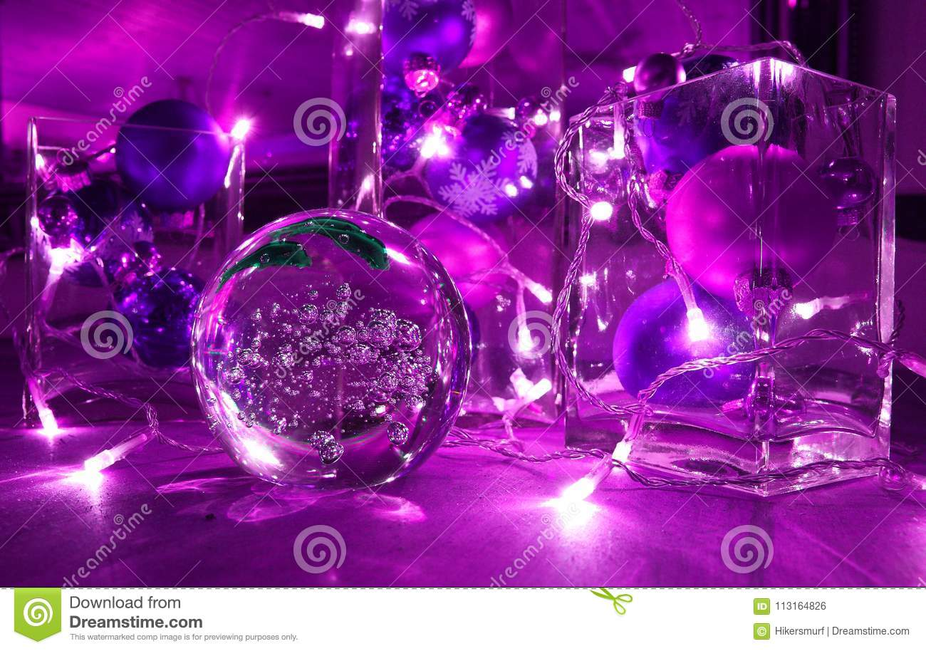 Christmas tree balls and jewellery with candle-lighted rally, in trend colour Ultra violet