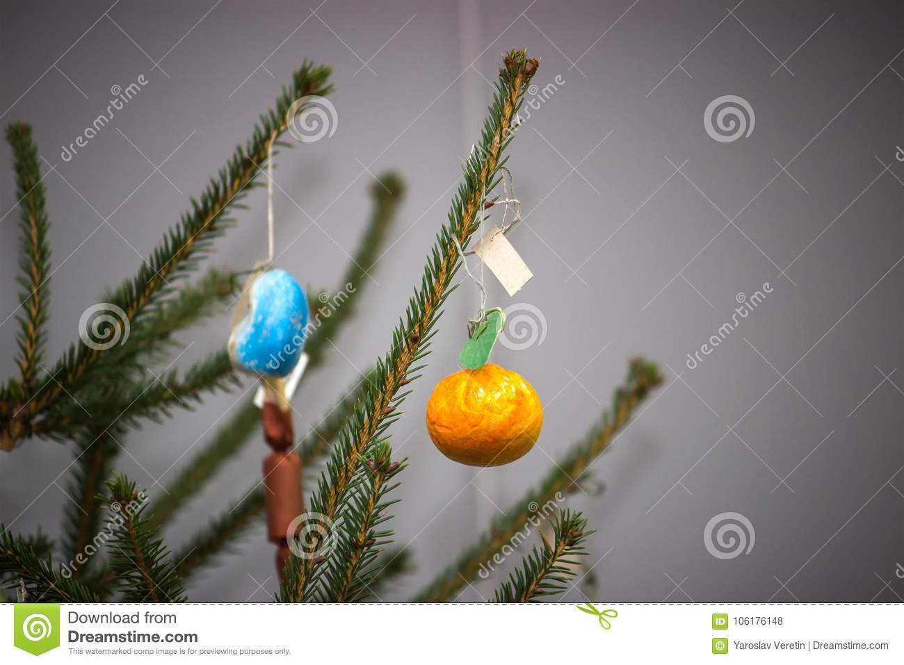 Christmas tree with baubles on dark background.