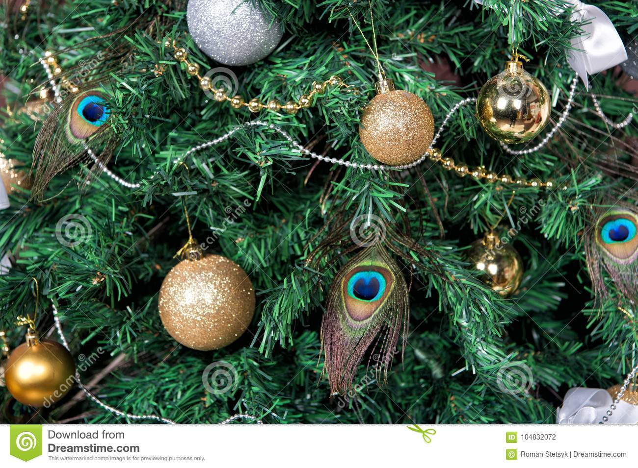 Christmas Tree With Baubles Peacock Feather Garlands Stock Photo