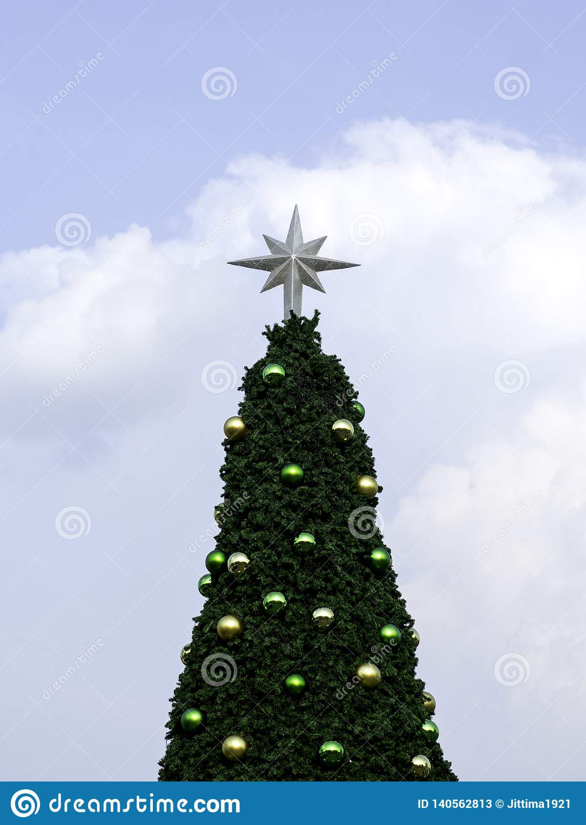 Christmas tree on blue sky