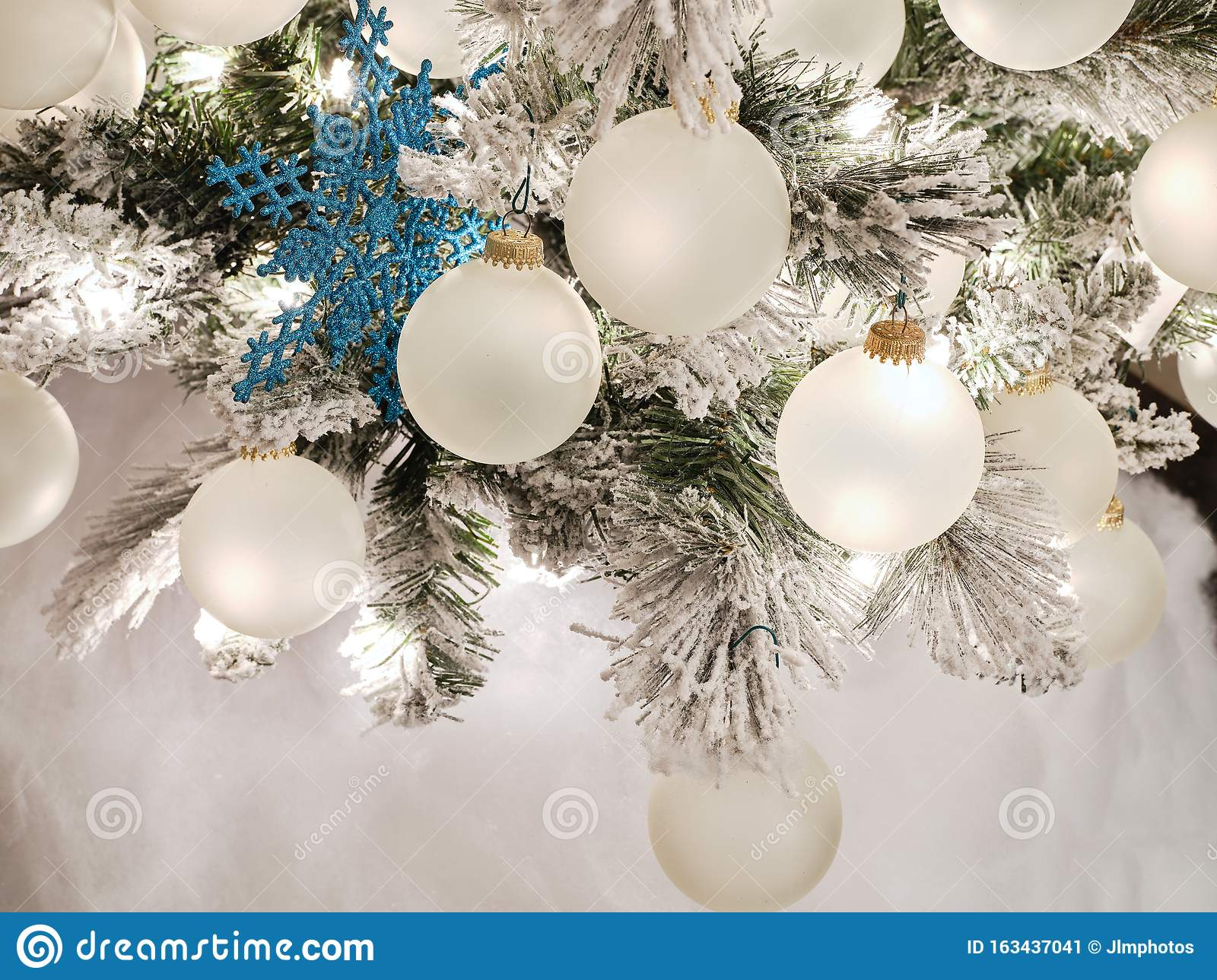 Tree with blue and white ornaments decorated for the thanksgiving and christmas holidays