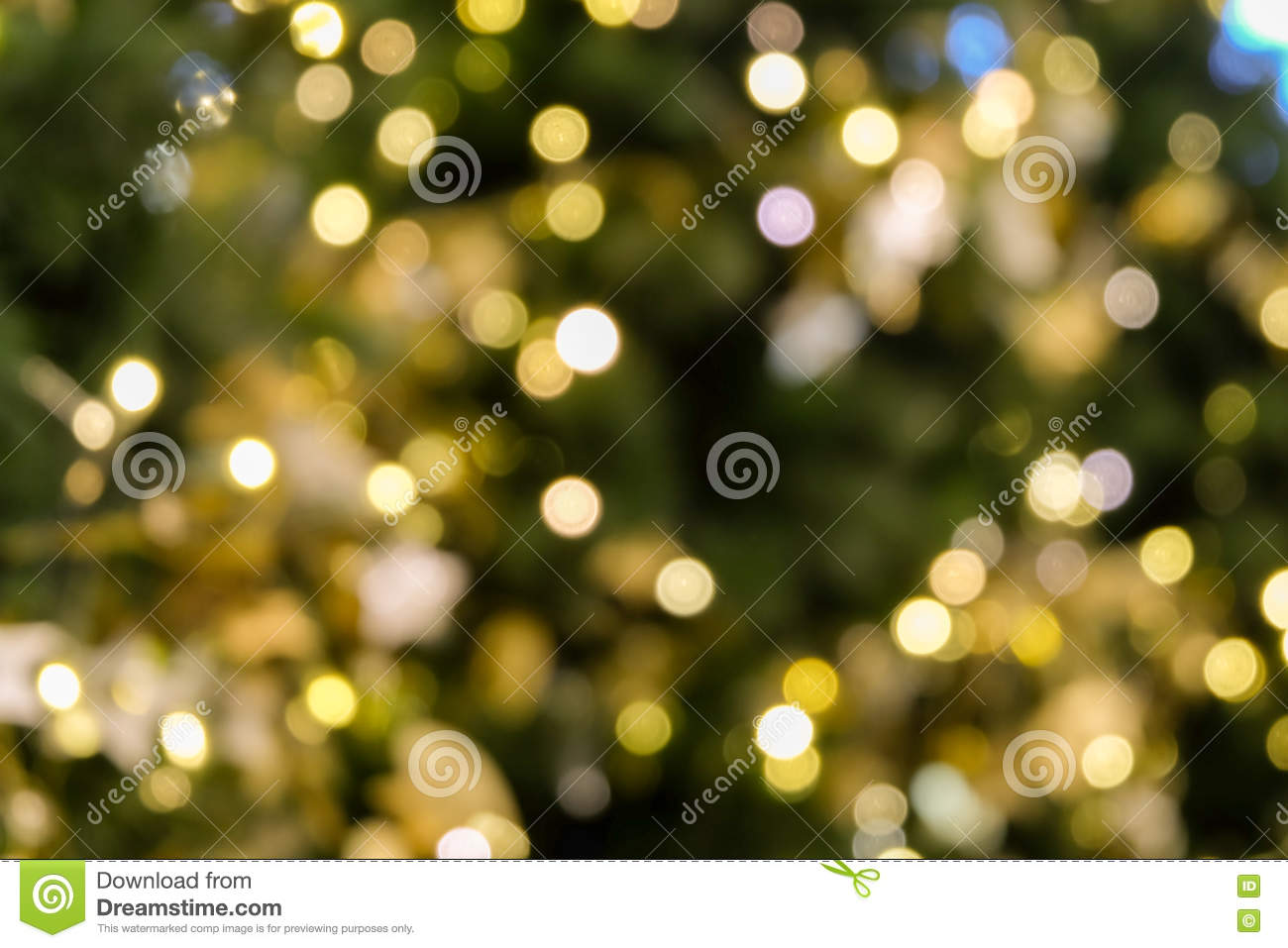 Christmas tree bokeh light in green yellow golden color, holiday abstract background, blur defocused