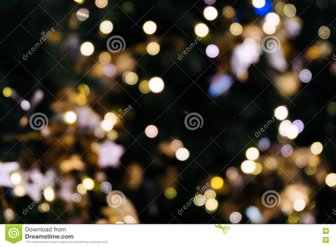 Christmas tree bokeh light in green yellow golden color, holiday abstract background, blur defocused with grain hipster color.