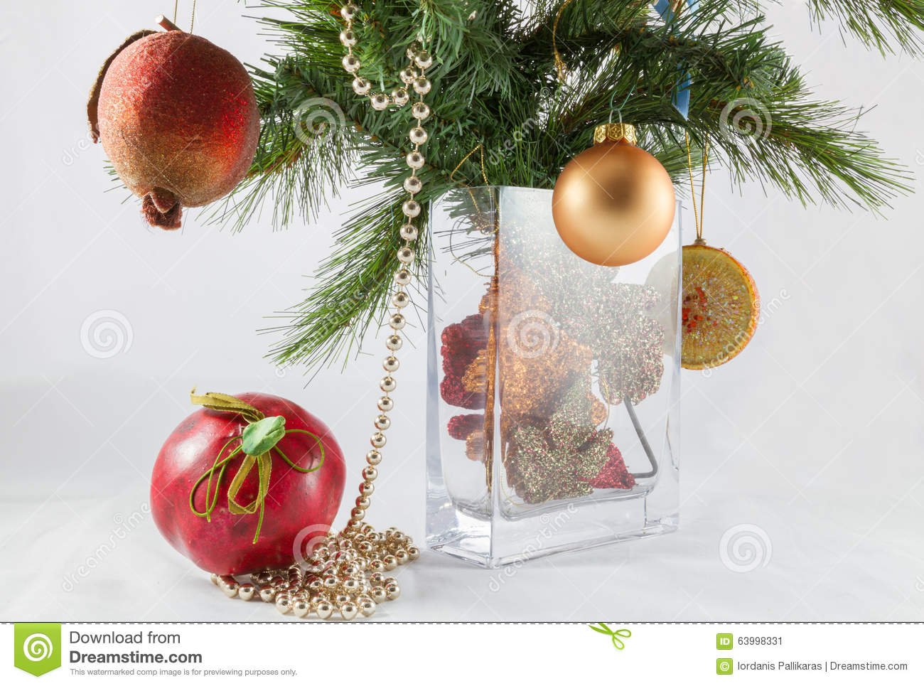 Christmas tree branch and decoration in a vase stock photo for Artificial pomegranate decoration