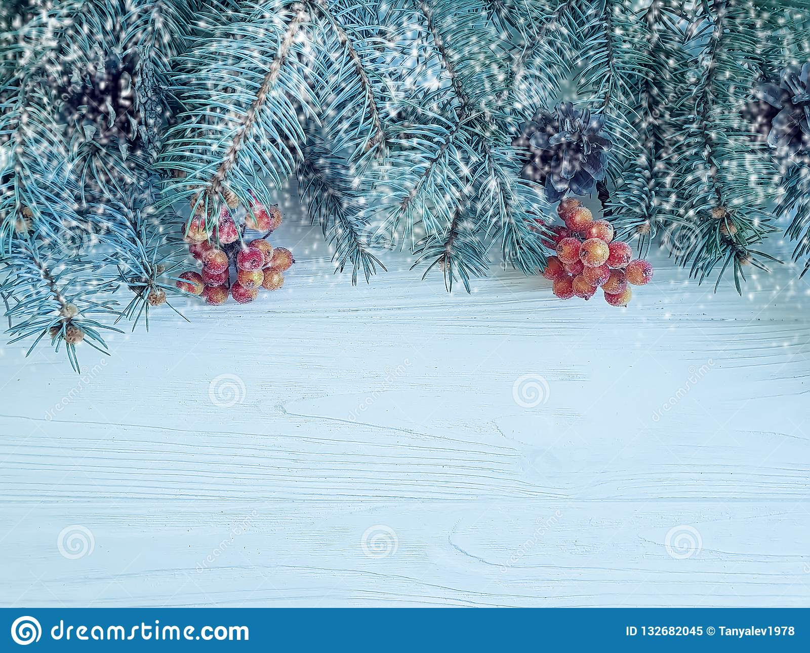 christmas tree branch festive card border on wooden