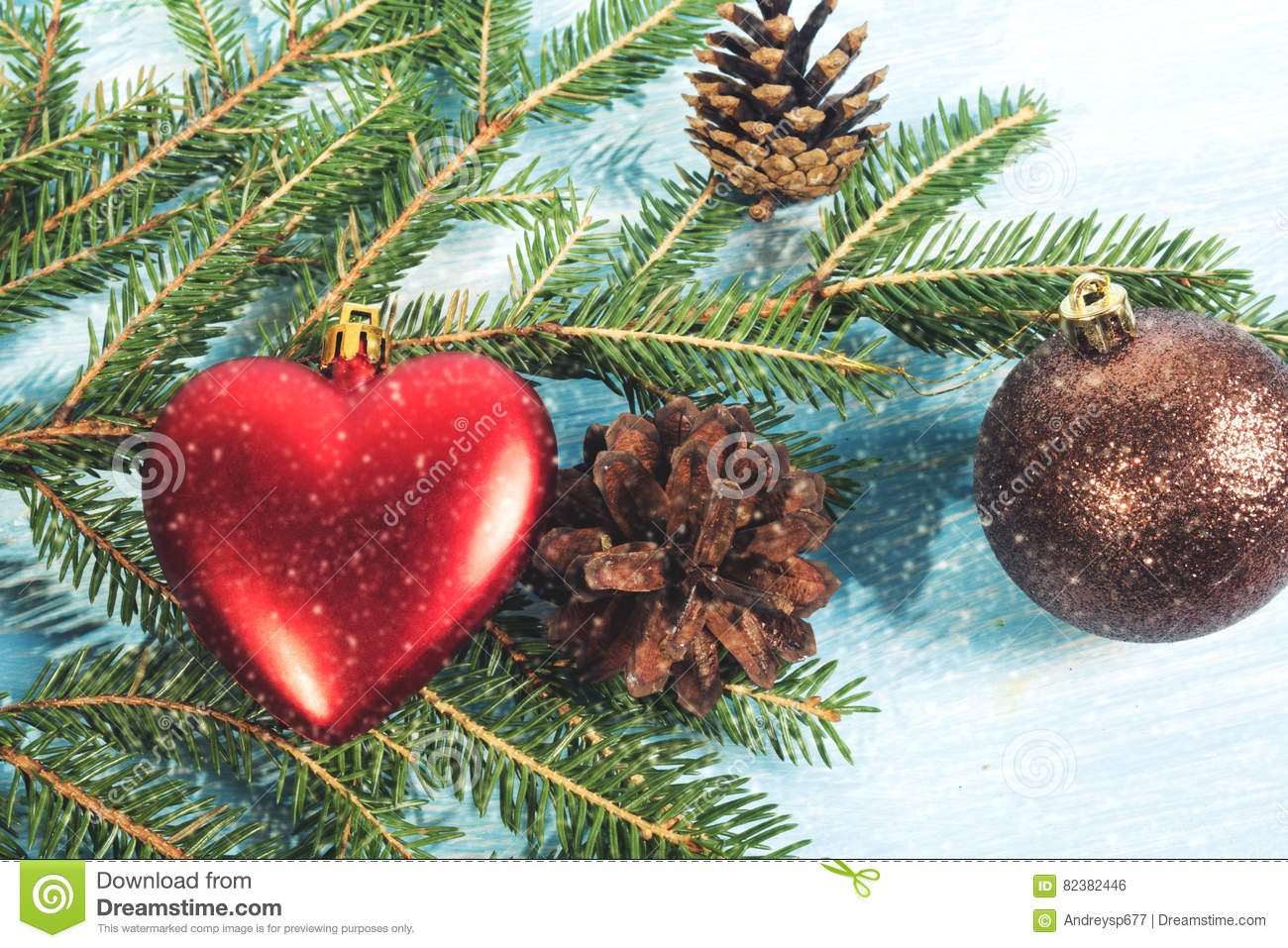 Christmas Tree Branch On Wooden Background With Heart
