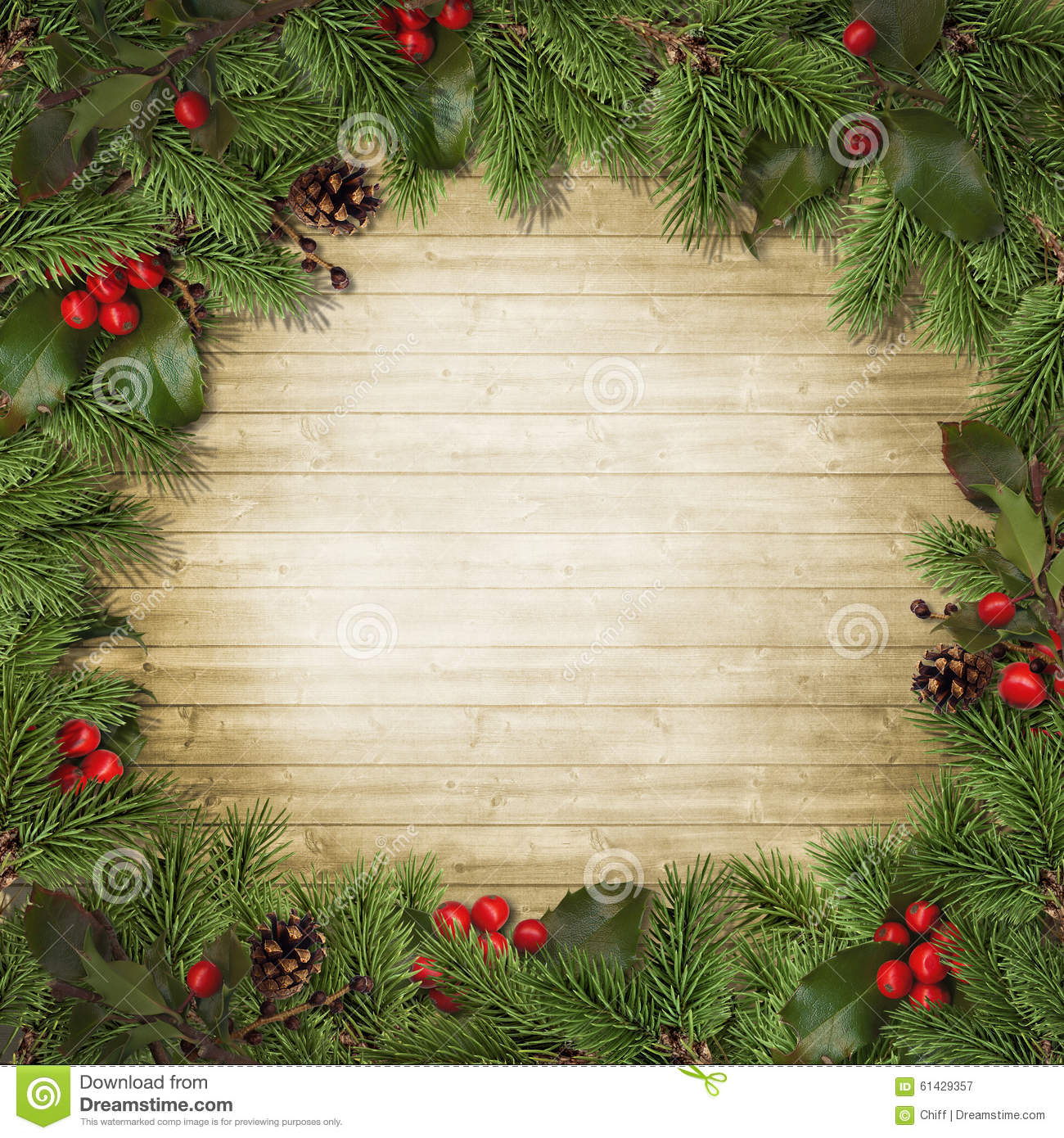 Christmas tree branches and holly on wooden board stock for Fir cone christmas tree decorations