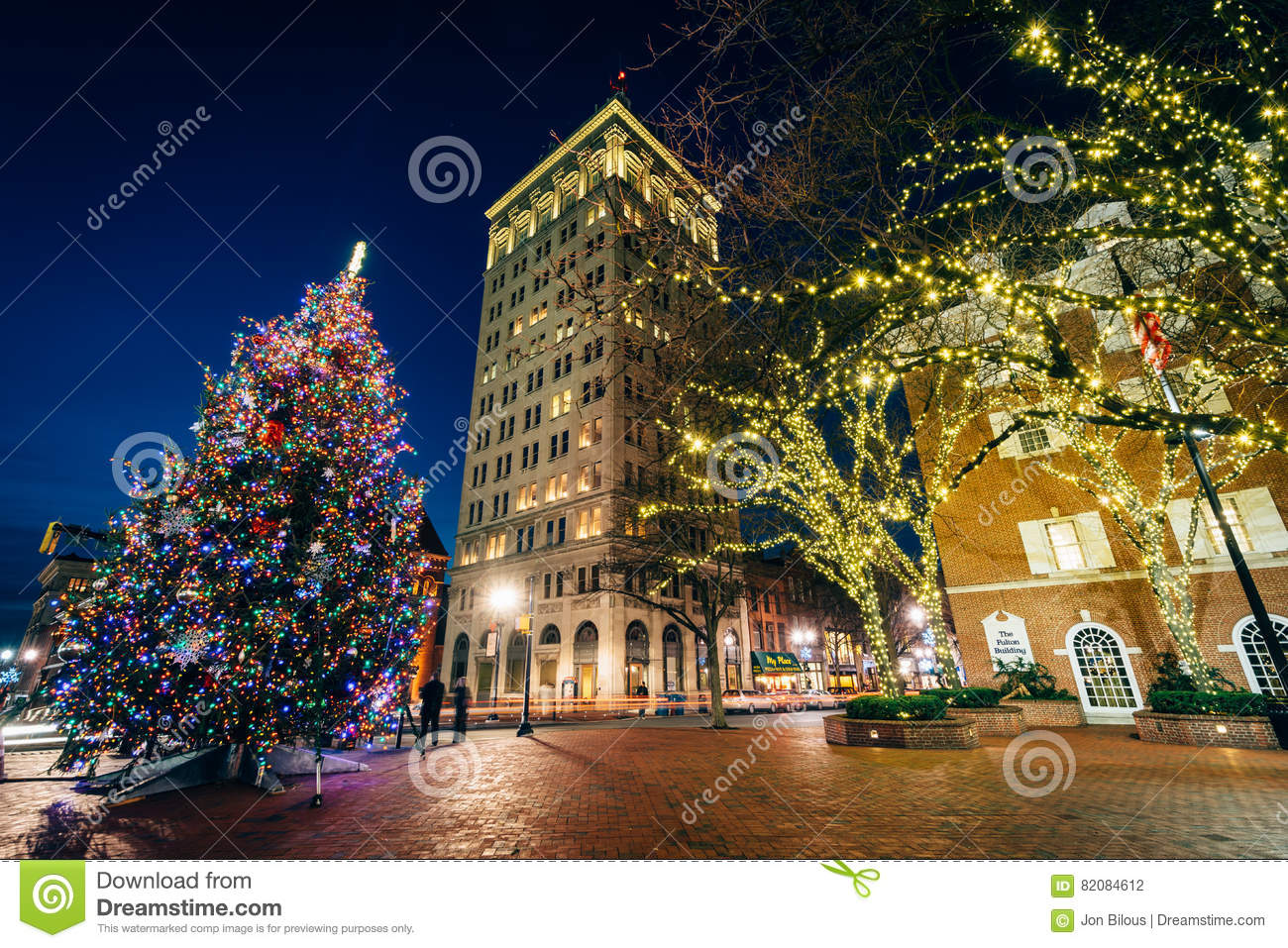 christmas tree and buildings at penn square at night in lancast