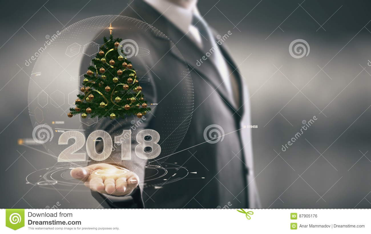 download 2018 christmas tree businessman holding in hand new technologies stock photo image of holding