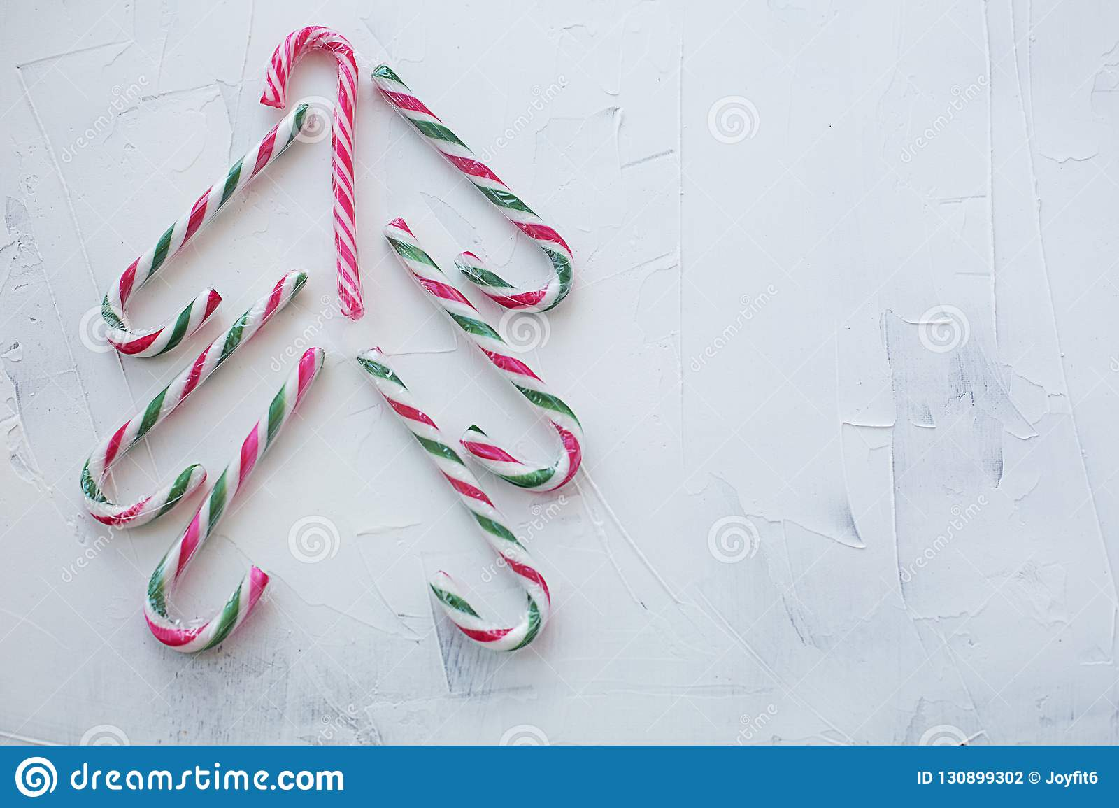 red white and green candy cane christmas tree