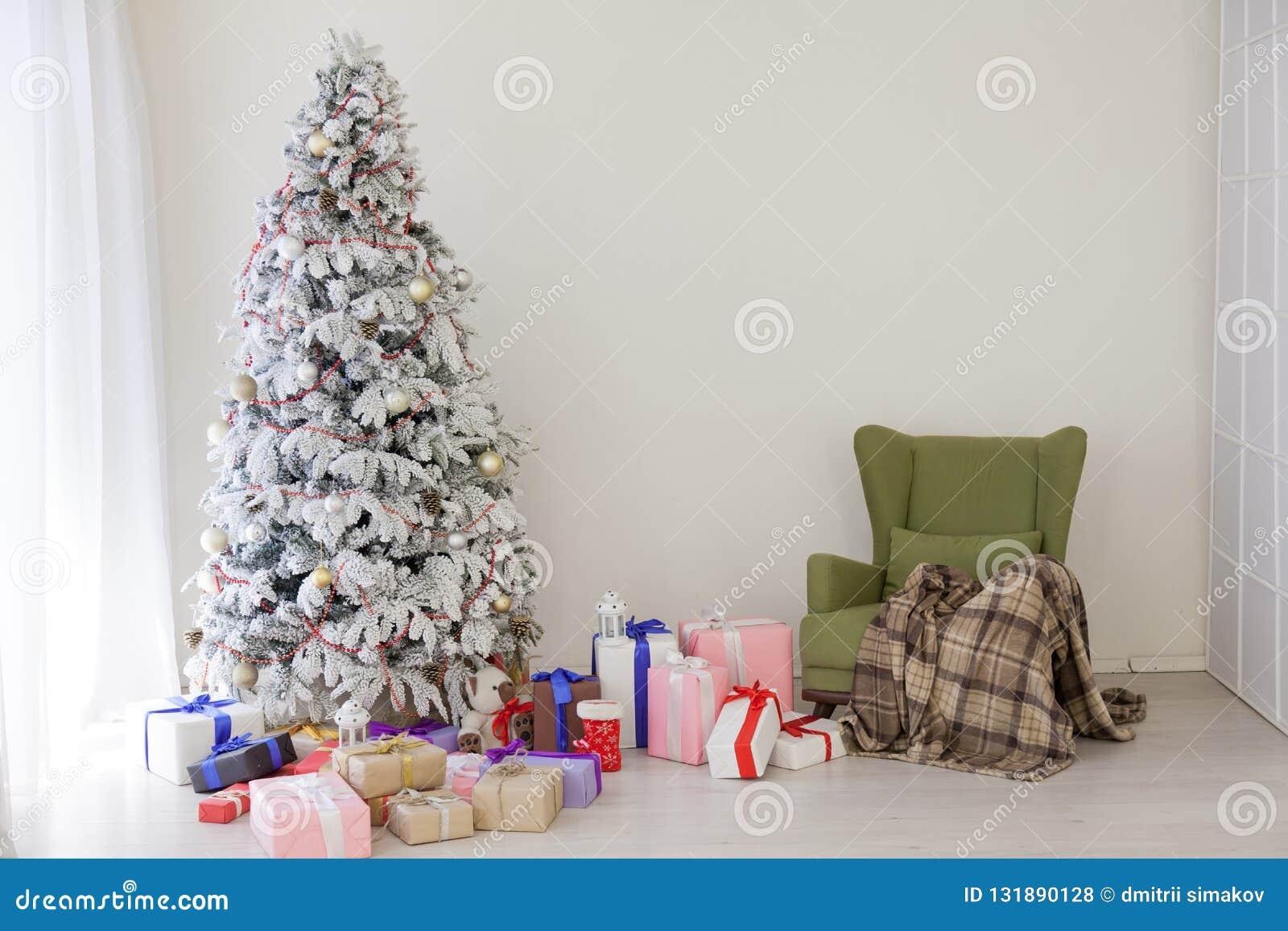 Christmas tree decor Interior white room new year gifts holidays. Christmas tree decor Interior white room new year holidays royalty free stock photos