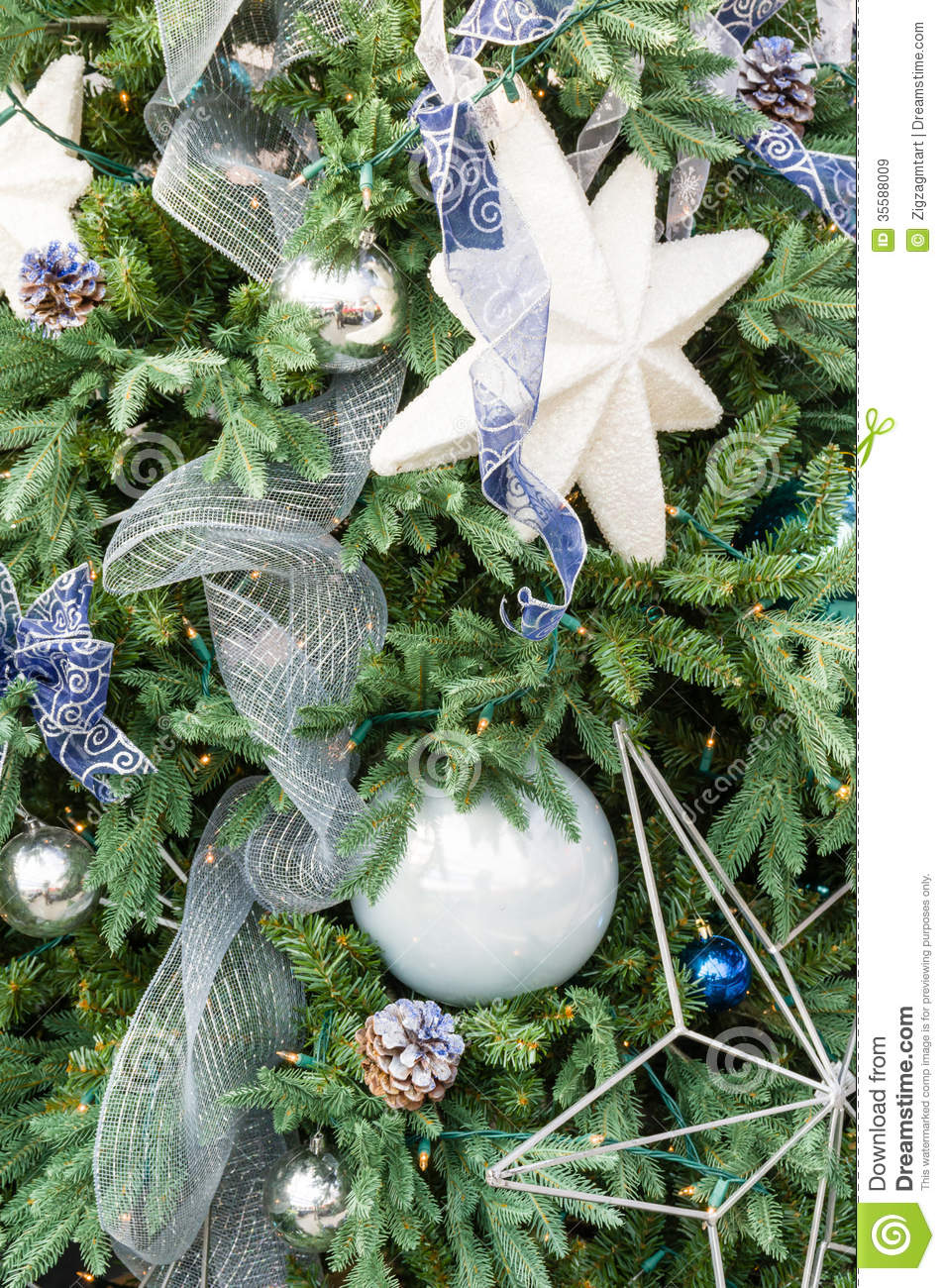 Decorated Christmas Tree Images : Christmas tree decorated with blue and white royalty free