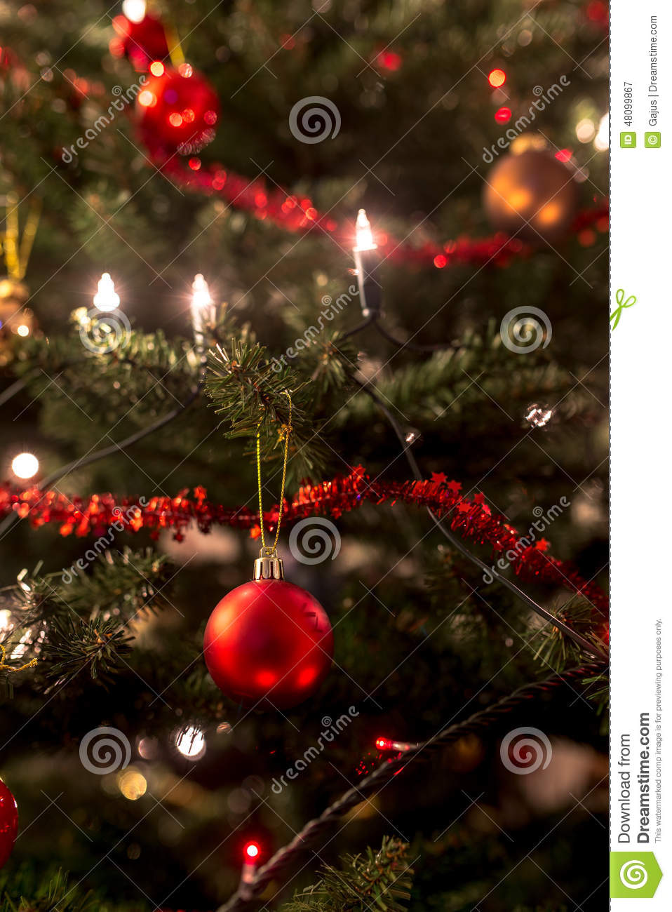 Christmas tree decorated with tinsel - Christmas Tree Decorated With Lights And Tinsel