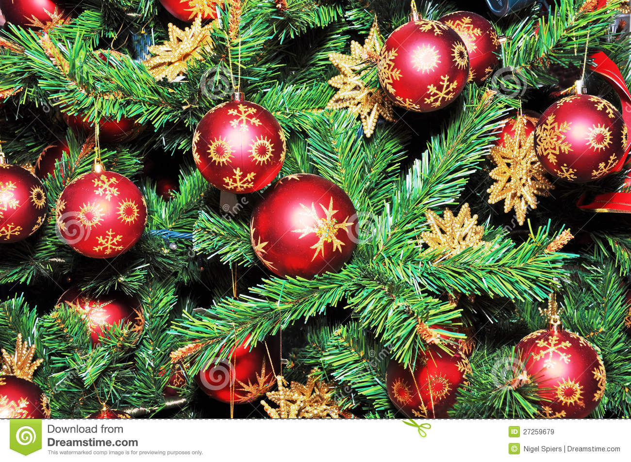 Christmas tree decorated with red balls stock image