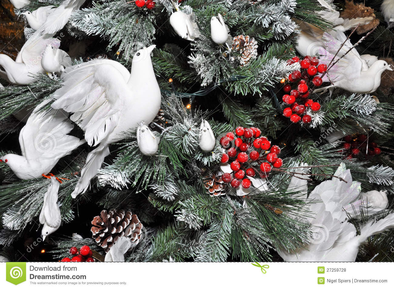 Christmas tree decorated with snow white doves stock